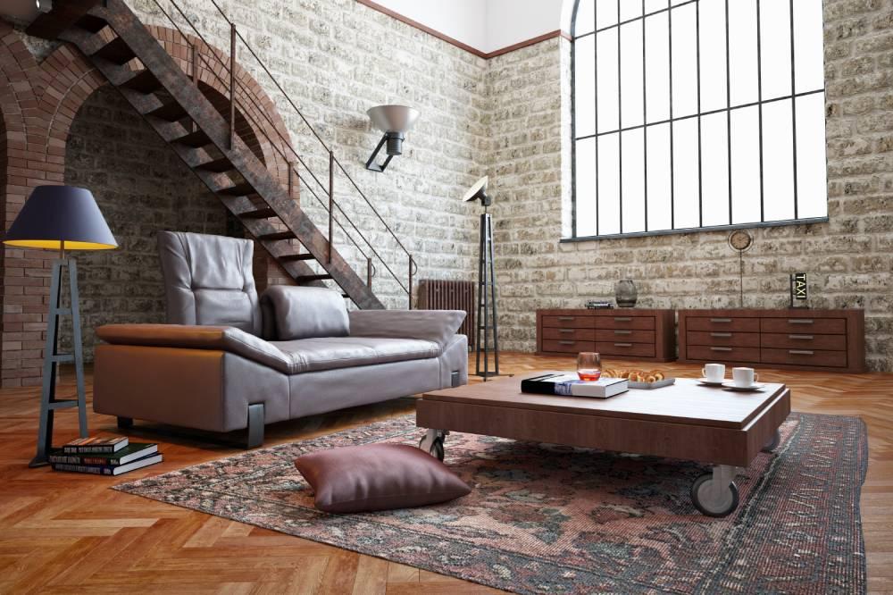 Wnętrze w stylu loft z ceglaną ścianą